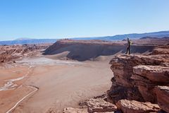 Man in atacama desert. Young man enjoying hiking and views at moon valley, valle de la luna, in atacama desert, chile, driest place on earth Royalty Free Stock Photos