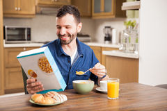 Young man enjoying his cereal Stock Photography
