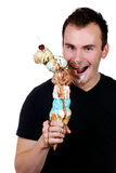 Young man enjoying his giant ice cream cone Royalty Free Stock Photo