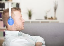 Young man enjoying his music Stock Photography