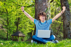 Young man enjoying with laptop Royalty Free Stock Photo