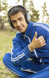 Young man enjoying listening to music on tablet Stock Image