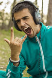 Young man enjoying listening to rock music Stock Photo