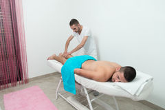 Young Man Enjoying A Massage Stock Photo