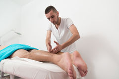 Young Man Enjoying A Massage Royalty Free Stock Photography