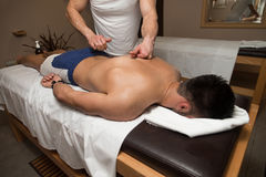 Young Man Enjoying A Massage Royalty Free Stock Images