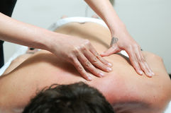 Young man enjoying massage at spa Royalty Free Stock Photography