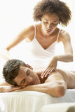 Young Man Enjoying Massage At Spa. With eyes closed Stock Images