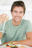 Young Man Enjoying Meal Stock Photography