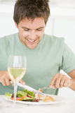 Young Man Enjoying Meal Stock Images