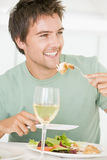 Young Man Enjoying Meal Royalty Free Stock Photo