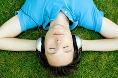 Young Man Enjoying Music Stock Image