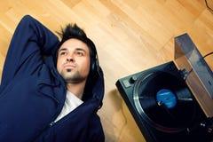 Young Man Enjoying Music Stock Photo