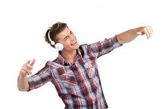 Young man enjoying music on headphones. Stock Photo