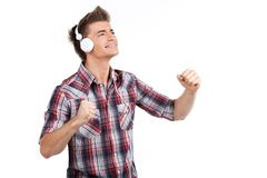 Young man enjoying music on headphones. Royalty Free Stock Photos