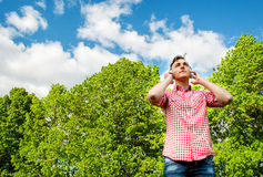 Young man enjoying music out in the park Royalty Free Stock Photography