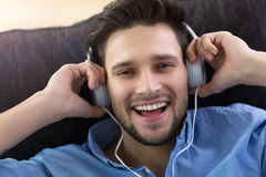 Young man enjoying music Stock Image