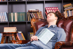 Young man enjoying a nap in the library Stock Photography
