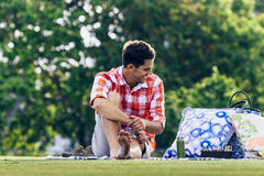 Young man enjoying picnic in park Stock Photography