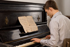 Young man enjoying playing an old melody Stock Photo