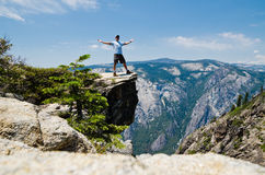 Young man enjoying reaching trail summit Royalty Free Stock Photo