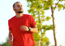 Young man enjoying a run outdoors Stock Photography