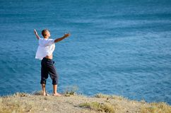 Young man enjoying the sea breeze Royalty Free Stock Image