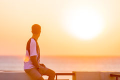 Young man enjoying sea view from the balcony Royalty Free Stock Photography