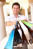 Young Man Enjoying Shopping Royalty Free Stock Image