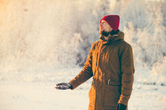 Young Man enjoying snow weather walking Outdoor Stock Images