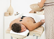 Young man enjoying spa treatment. Young man enjoying the treatment in spa salon Royalty Free Stock Photos