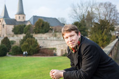 Young man enjoying spring sunshine in a German city Stock Photography