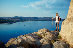 Young man enjoying stunning view in Porto Giunco near Villasimius, Sardinia, Italy Royalty Free Stock Images