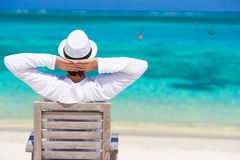 Young man enjoying summer vacation on tropical Royalty Free Stock Images