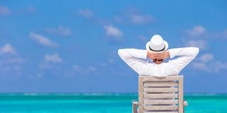 Young man enjoying summer vacation on tropical Royalty Free Stock Image