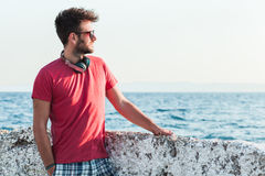 Young man enjoying sunset Stock Photo