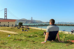 Young man enjoying time and famous sightseeing in san francisco - golden gate bridge Royalty Free Stock Images