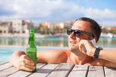 Young man enjoying vacation in luxury resort Stock Images