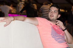 Young  man  enjoying the vacation in a night bar Stock Photo