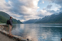 Young man enjoying the view of fjord, Norway Royalty Free Stock Photo