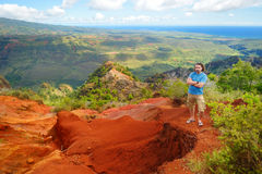 Young man enjoying a view into Waimea Canyon Stock Photo
