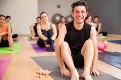 Young man enjoying yoga class Royalty Free Stock Images
