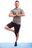 Young man enjoying yoga practice Stock Images