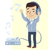 Young man enjoyment music. In big headphones Royalty Free Stock Image