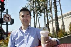 Young man enjoys a hot drink Stock Photos