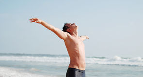 Young man enjoys the sun Stock Photography