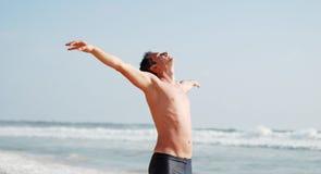 Young man enjoys the sun Stock Photography