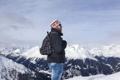 Young man enjoys the view in the mountains Stock Photos