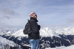 Young man enjoys the view in the mountains Royalty Free Stock Images