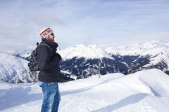 Young man enjoys the view in the mountains Stock Photo